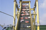 Aluminum Cans Moving Along a Conveyor at a Recycling Center in Santa Monica, California Photographic Print