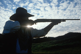 Silhouette of Cowboy Shooting Rifle Photographic Print