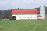 A Yellow Airplane, Red Barn, and Grain Silo on a Farm in WV Photographic Print