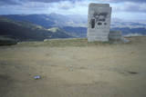 A Largely Empty Lot with a View of the Mountains Photographic Print