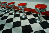 Art Deco Restaurant with Checkered Floor and Red Stools in Niagara Falls, NY Photographic Print