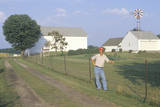 A Farmer Standing by a Fence During a Drought in South Bend, IN Photographic Print