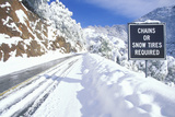 """A Sign That Reads """"Chains or Snow Tires Required"""" Photographic Print"""