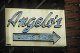 "A Neon Sign That Reads ""Angelo's Since 1902"" Photographic Print"