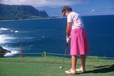 Female Golfer Putting in Kauai, Hawaii Photographic Print