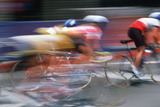 Bicycle Racers Speeding Past in Subaru Bicycle Race, Beverly Hills, California Photographic Print