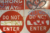 """Red Signs Reading """"Wrong Way, Do Not Enter"""" Covered with Graffiti Los Angeles Photographic Print"""