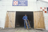 Man Coming Out of a Feed Store in Sandpoint, ID Photographic Print