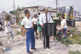 Mayor Tom Bradley Overseeing Urban Cleanup Efforts on Earth Day Photographic Print