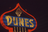 "A Neon Sign That Reads ""Dunes"" Photographic Print"