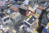 A Pile of Car Batteries Ready for Disposal Photographic Print