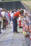 Woman Tracing Name of Soldier on the Vietnam Wall Memorial, Washington, D.C. Photographic Print