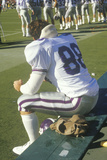 Close-Up of College Football Player Deep in Thought on Bench, West Point, NY Photographic Print