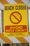 A Beach Closed Warning Sign Photographic Print