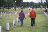 Elderly Veteran and Wife in Cemetery, Los Angeles, California Photographic Print