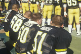 View from Behind of Group of College Football Players Sitting on Bench During Game, West Point, NY Photographic Print