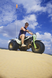 A Man Riding a Three-Wheeled All-Terrain Vehicle in Little Sahara State Park, Oklahoma Photographic Print