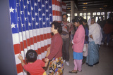 Ethnic Family Visiting an Exhibit at Ellis Island National Park, New York Photographic Print