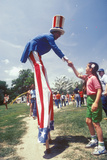 Man on Stilts Dressed as Uncle Sam Shaking Girl's Hand, Salina, Kansas Photographic Print