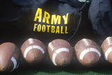 Close-Up of Row of Footballs and Army Football Logo, Michie Stadium, NY Photographic Print