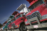 Bright Red Mack Dump Trucks Line the Road in a Row, in Maine Near the New Hampshire Border Fotodruck