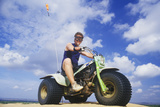 A Man Astride a 3-Wheeled Recreational Vehicle in Little Sahara State Park, Oklahoma Photographic Print