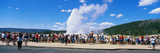 This Is the Famous Old Faithful Geyser. the Geyser Is Erupting in Front of a Crowd of Tourists Photographic Print