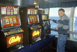 A Ferry Passenger at the Slot Machines, En Route to Nova Scotia Photographic Print
