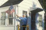 Old Man Putting American Flag on House, Stonington, Maine Photographic Print