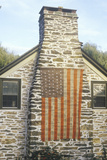 American Flag Hung on Stone Chimney of House, New England Photographic Print