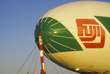 The Fuji Blimp Shipping Off at Sunrise in New York Photographic Print