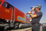 A Father and Son in Engineer CAps Look at a Historic Santa Fe Diesel Train in Los Angeles, CA Photographic Print