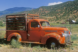An Old, Orange Truck Rests Abandoned in a Colorado Field, Snowmass, Colorado Photographic Print