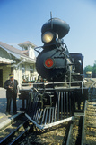 A Steam Engine Conductor as He Stands Near the Cowcatcher on the Front, Eureka Springs, Arkansas Photographic Print