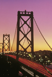 This Is the Bay Bridge at Sunset. There Is a Pink and Orange Glow in the Sky Photographic Print