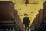 A Train Conductor Aboard a Standard Gauge Steam Engine Train in Eureka Springs, Arkansas Photographic Print