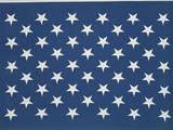 These are the Stars of the American Flag. They Lay Flat Against their Blue Background Photographic Print