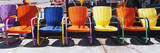 This Is a Close Up of Multi-Colored Metal Lawn Chairs. They are Located Outdoors on Route 66 Photographic Print