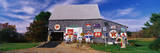 This Is a New England Barn with Numerous Signs Posted on the Outside of It Photographic Print