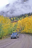 Autumn Aspens and Clouds at the Kebbler Pass in Gunnison National Forest, Colorado Photographic Print