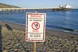 "A ""Warning - No Swimming"" Sign Due to Pollution at a Malibu Beach, Malibu, California Photographic Print"
