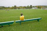 A Boy Rests on a Bench During School Soccer Practice, New Hampshire Photographic Print