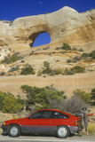 Window Rock Arch in Southern Ut with Red Car in Foreground Photographic Print