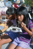 Two Girls Eating Noodles at 49th Nisei Week Parade in Little Tokyo, Los Angeles, CA Photographic Print