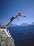 Man Diving into Crater Lake, Oregon Papier Photo