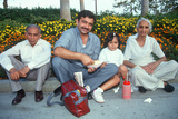An Indian Family in Pomona, Ca Sitting on the Curb Photographic Print