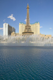 Water Fountain Display at Bellagio Casino with Paris Casino and Eiffel Tower in Las Vegas, NV Photographic Print