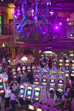 Rows of Slot Machines and Gamblers at Rio Casino in Las Vegas, NV Photographic Print