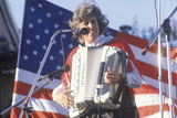 A Woman Plays the Accordion in Front of the American Flag, Hannibal, MO Photographic Print