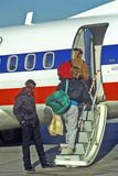 Passengers with Luggage and Backpacks Boarding Small Plane Photographic Print